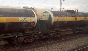 Грузовой поезд, серная кислота.